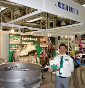 Sales Engineers Giovanni Salgado and Pedro Diaz at Russell Finex Stand at Exposolidos